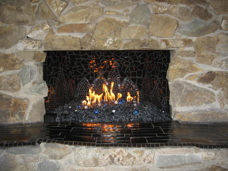 Mosaic fireplace with remote.