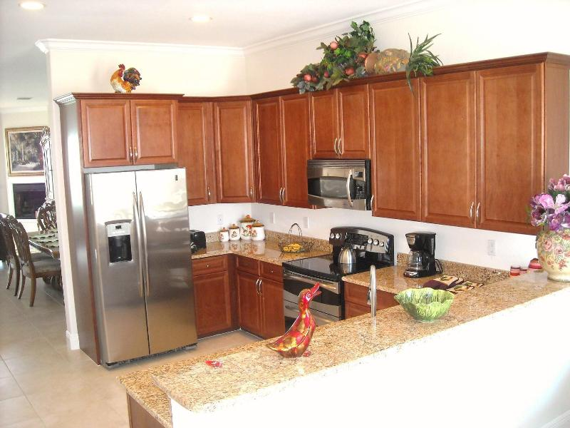 Exotic granite, many cabinets, stainless steel appliances inspire chefs to create meals