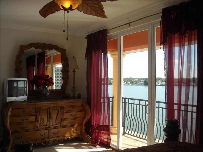 Master bedroom, 9 ft sliding glass door open to east balcony