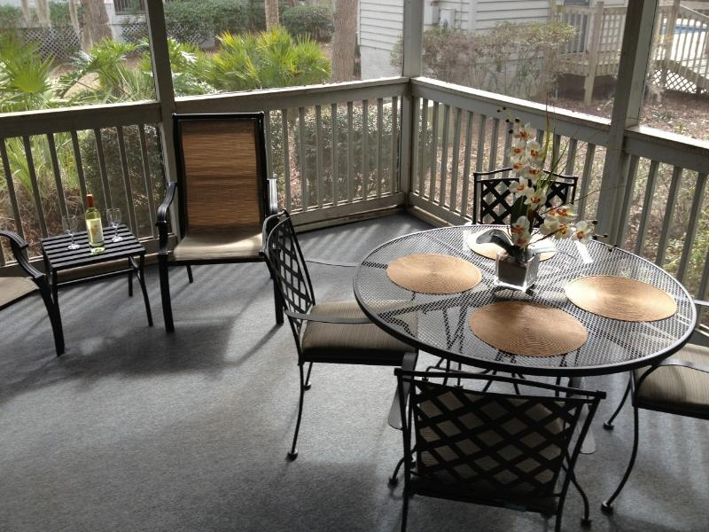 Relax & enjoy outdoor dining on our spacious screened patio