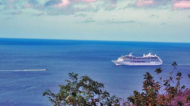 View from the house and terrace of the ocean with cruise ships arriving and mooring in front.