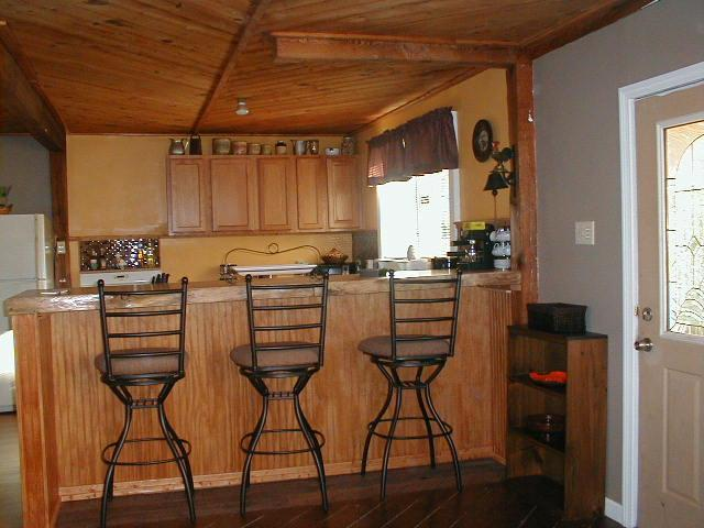 Awesome pine slab bar top...overlooks kitchen open to living area