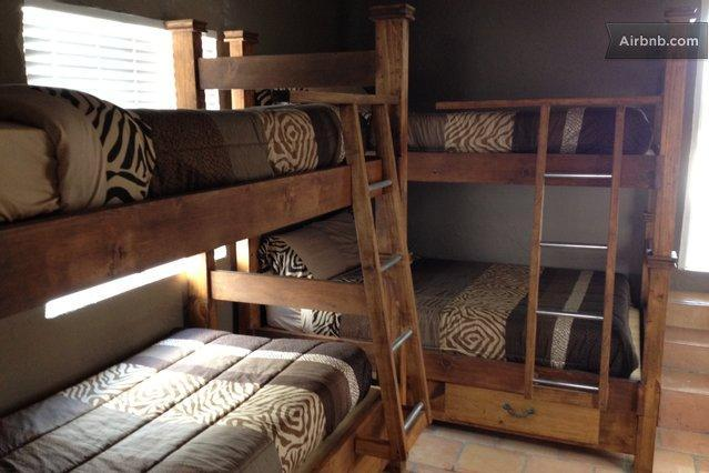Bedroom with two twin bunk beds in small guest house