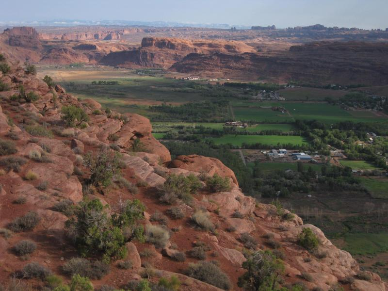 View of Moab from the Moab Rim Trail, Arches National Park is in the distance