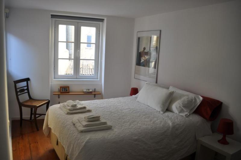 Room with double bed and windows with full blinds