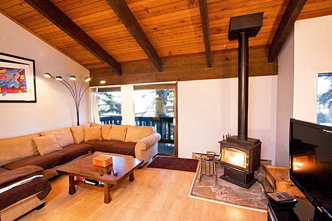 Mammoth Point #123 Living Area With A Wood Burning Fireplace