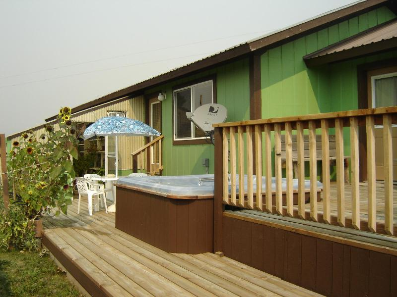 Our deck with out door table & chair plus hot tub