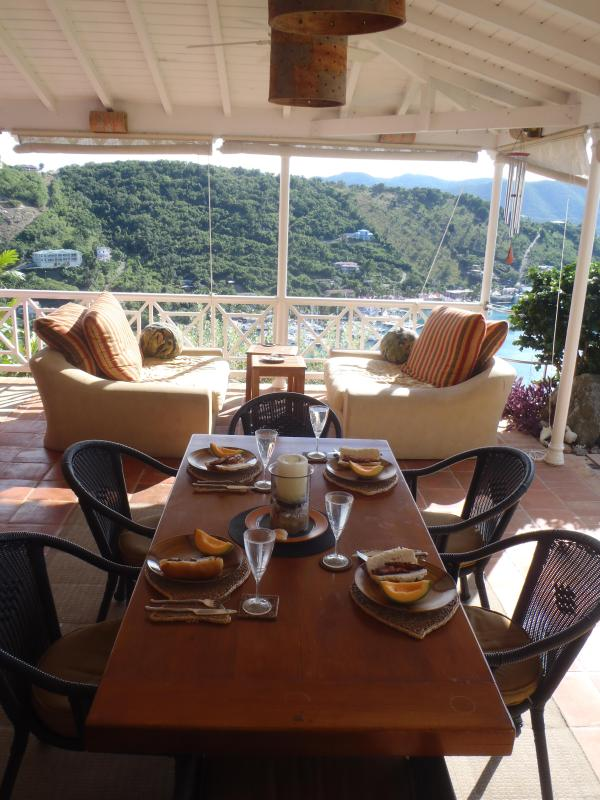 Dining veranda with shades which can be drawn for a relaxing, cool afternoon break