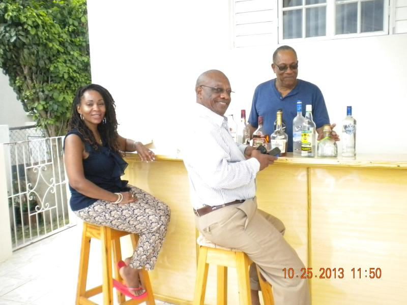 Villa guests with Owner/Manager enjoying purpose-built outdoor bar.