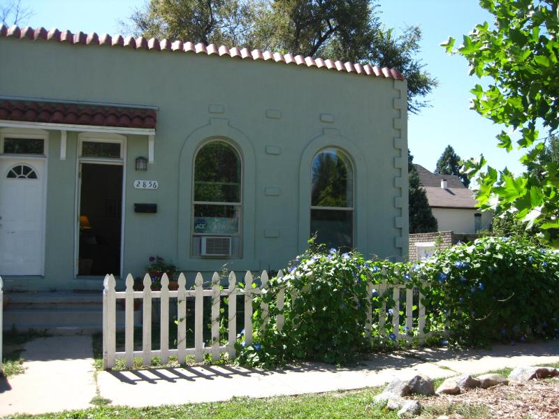 Outside view of 1890's adobe duplex.  Very walkable, coffee shop 1 blk!