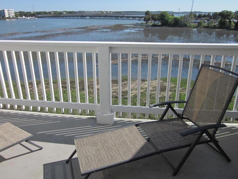 Balcony off master bedroom with gorgeous views of Folly River.