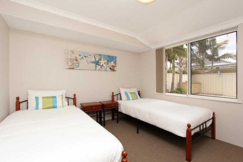 Bedroom 3 (2 King Single Beds) with Pool View