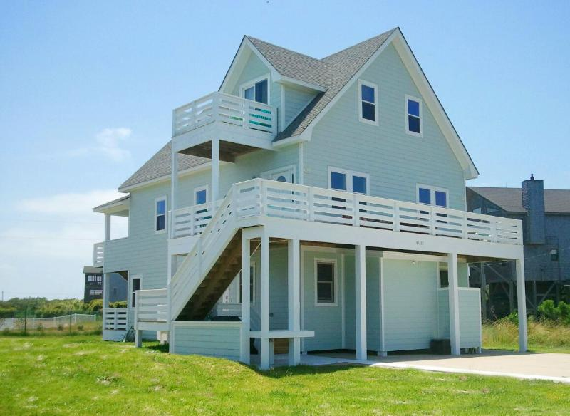 Front View of Home Featuring Expansive Furnished Decks and Ocean Views