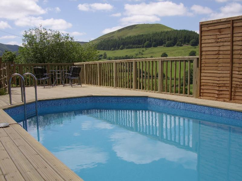 Heated swimming pool with stunning views