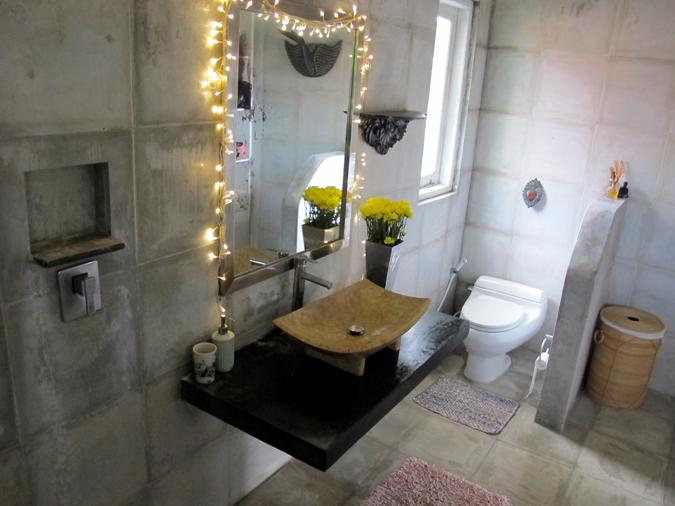 Master bathroom with large shower head and black resin bath