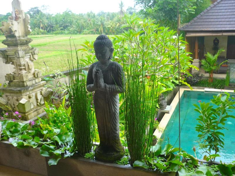 Buddha above the pool