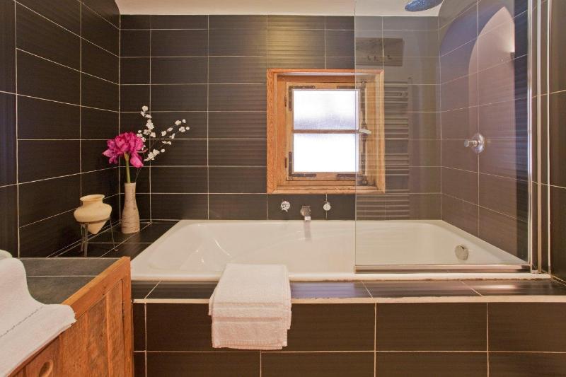 Bathroom with shower and deep fill bath