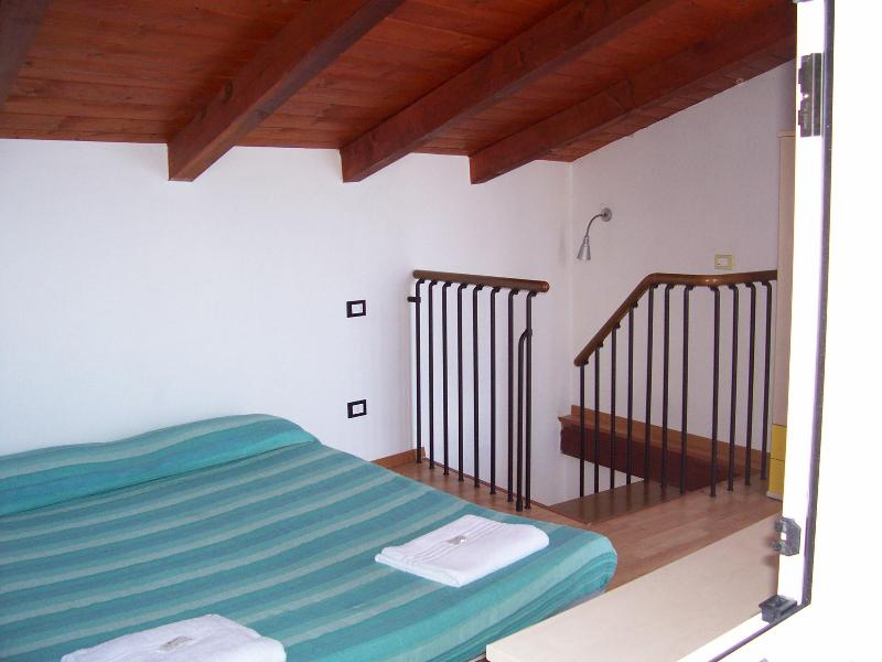 THE BEDROOM WITH THE LITTLE BALCONY