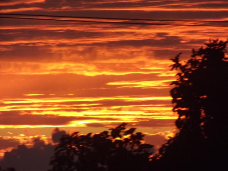 A breathtaking sunset taken from our yard.