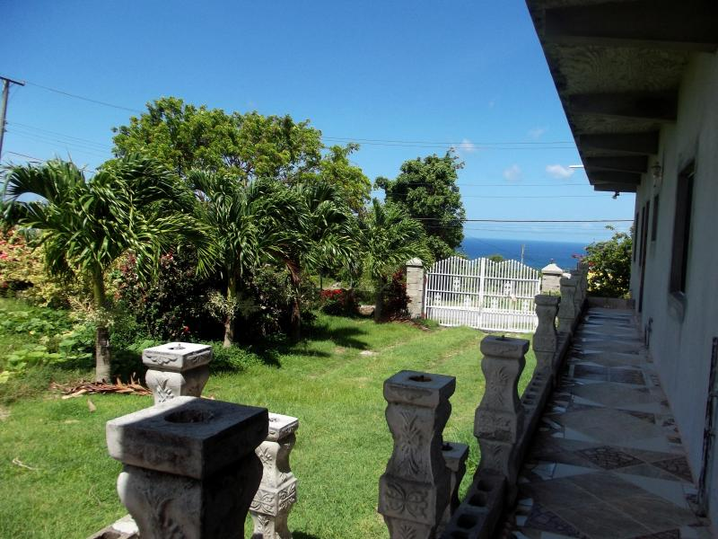 View from the apartment, into the gardens and the Caribbean Sea.