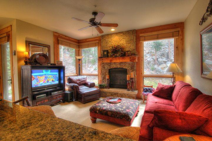 Living Room - The spacious living room features a natural stone gas fireplace and a flat screen TV.