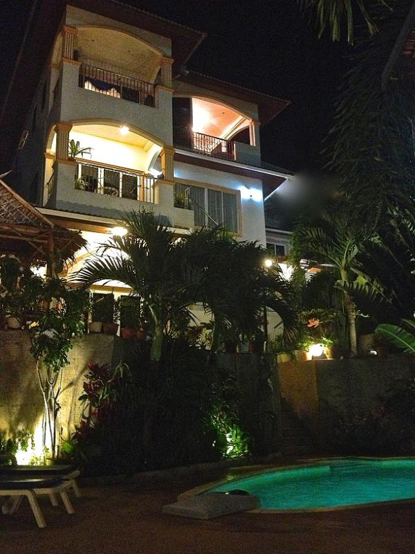 OASIS Villa at night with private pool