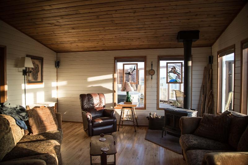 living room with woodstove at sunset