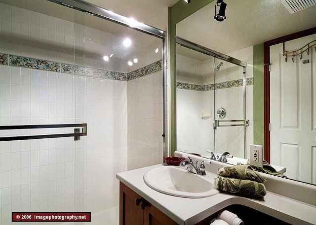 This home has three bathrooms, two showers and a jacuzzi tub