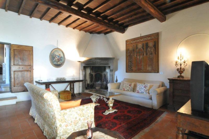 The living room with ancient Tuscan Sandstone fireplace, video/books library, board games