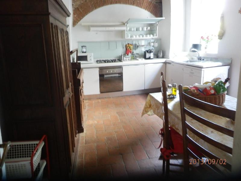 Fully equipped tuscan country kitchen with welcome basket