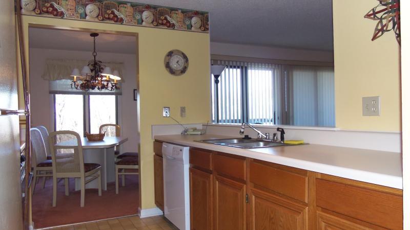 Kitchen toward dining area & porch