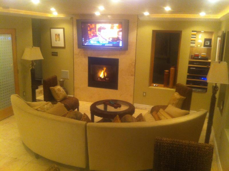Enjoy the gas powered, remote controlled Fireplace and Big Screen TV