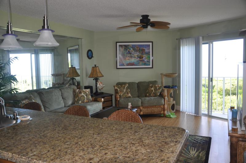 Tropical elegance & comfort with 'green' bamboo flooring, home theater and spectactular ocean views.