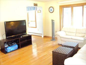 Livingroom with large flat screen HDTV and  Blue Ray DVD Player