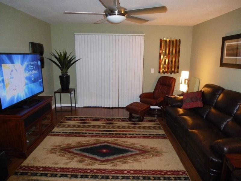 Living Room with 65' Flat Screen TV!