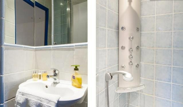 small bathroom with washbasin and shower
