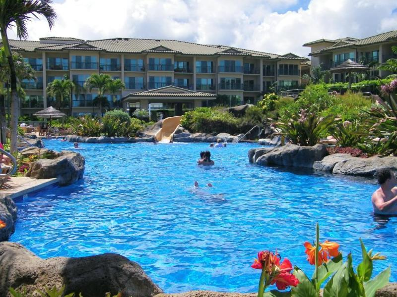 Enjoy the 2 acre heated Fantasy pool with slides, waterfalls, caves. sand bottom wading pool & spas