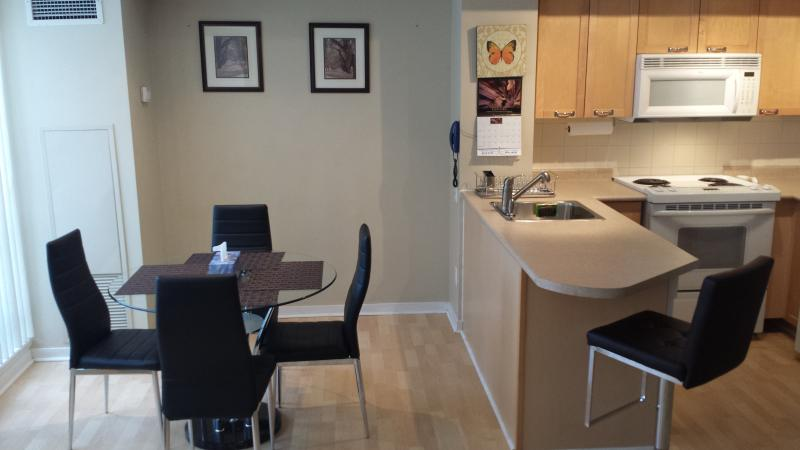 Apt.A.Living and dining area with HD LED TV