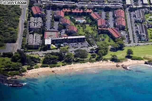 Property proximity to the beach park. Ours is the end unit of the left, second red roofed building