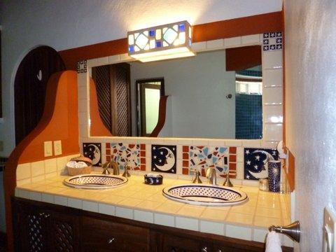 Double sinks in this bathroom.  They honor the gentle moon.