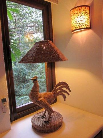 The artwork has been commissioned to fit perfectly in this bedroom.  The roosters are very quiet.