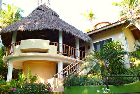 Notice the Palapa roof; it's 'a low hanging roof,' which creates an amazing intimacy, sorta saced.