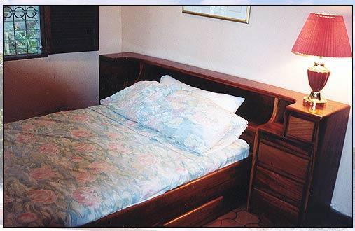 An air conditioned bedroom with unobstructed views of the ocean 30 yds away