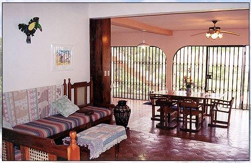 The living room and dining room is an open air screened in room (really cool!), with overhead fans. There is no air conditioning in this portion of the house, including the kitchen. There are two couches and an entertainment center