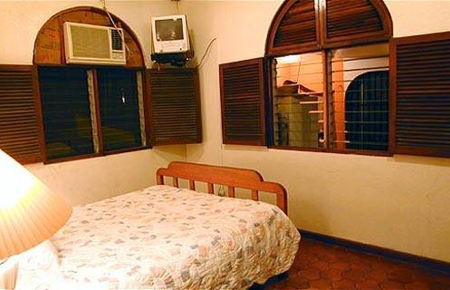 Our beach house has 4 bedrooms which are equipped with air-conditioning and overhead fans. The front bedrooms have a double bed and dresser made out of beautiful dark native woods. They also have a mirror and a free standing closet to hang your clothes