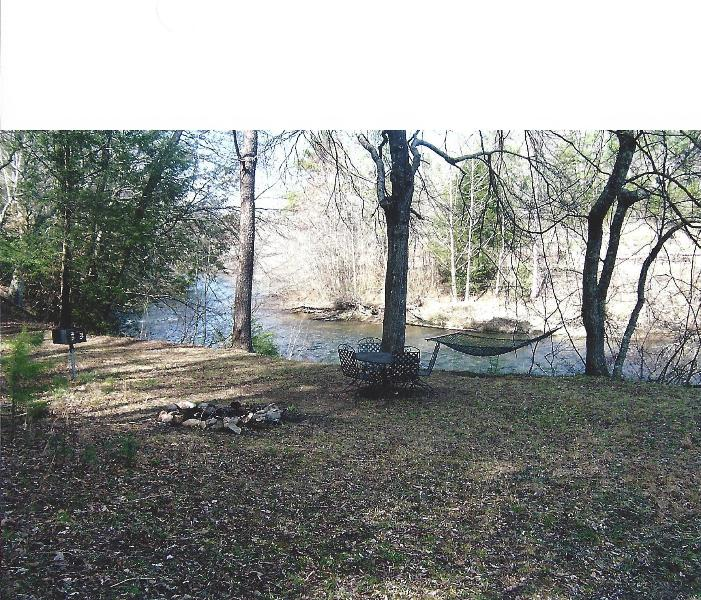 River front with dinning table and chairs,firepit ,grill and hammock