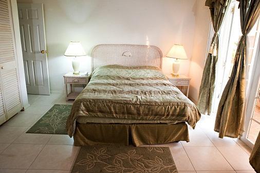 The green bedroom in quiet splendour.