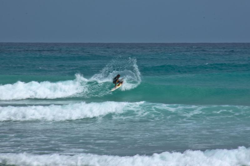 Surfing at Freighter's Point, two minutes away from our property.