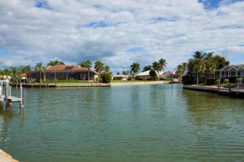 Wide water view from screened lanai, kitchen, leaving room & master bedroom. Dock/lift available
