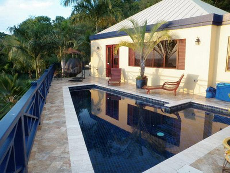 Private freshwater pool with plenty of patio furniture and gas grill